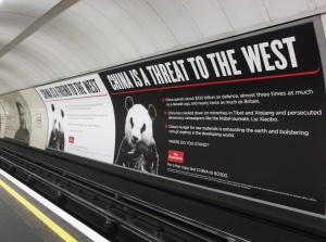 Two Economist Posters Hung Side by Side in a London Tube